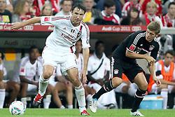 26-07-2011 VOETBAL: AUDI CUP 2011 FC BAYERN MUNCHEN - AC MILAN: MUNCHEN<br /> Mark van Bommel (Milan #4) im Kampf mit Toni Kroos (Bayern #39)<br /> ***NETHERLANDS ONLY***<br /> ©2011-FRH- NPH/Straubmeier