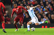 Nani of Portugal battles Angel Di Maria of Argentina - Argentina vs. Portugal - International Friendly - Old Trafford - Manchester - 18/11/2014 Pic Philip Oldham/Sportimage