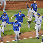 Salvador Perez, (left), celebrates with teammates as Kansas City Royals win the World Series and empty the dugout during the New York Mets Vs Kansas City Royals, Game 5 of the MLB World Series at Citi Field, Queens, New York. USA. 1st November 2015. Photo Tim Clayton