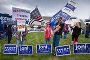 28 SEPTEMBER 2020 - JOHNSTON, IOWA: Supporters of US Senator Joni Ernst stand in the rain before the US Senate debate at the Iowa PBS studios in Johnston. Both US Senator Joni Ernst, the Republican incumbent, and Theresa Greenfield, the Democratic challenger, had rallies before the debate. Polling puts the race within the margin of error.    PHOTO BY JACK KURTZ