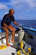 Don DeMaria drops tissue sample from Goliath grouper or jewfish, Epinephelus itajara, into liquid nitrogen,<br /> Florida ( Gulf of Mexico ) <br /> FSU-NMFS jewfish research project