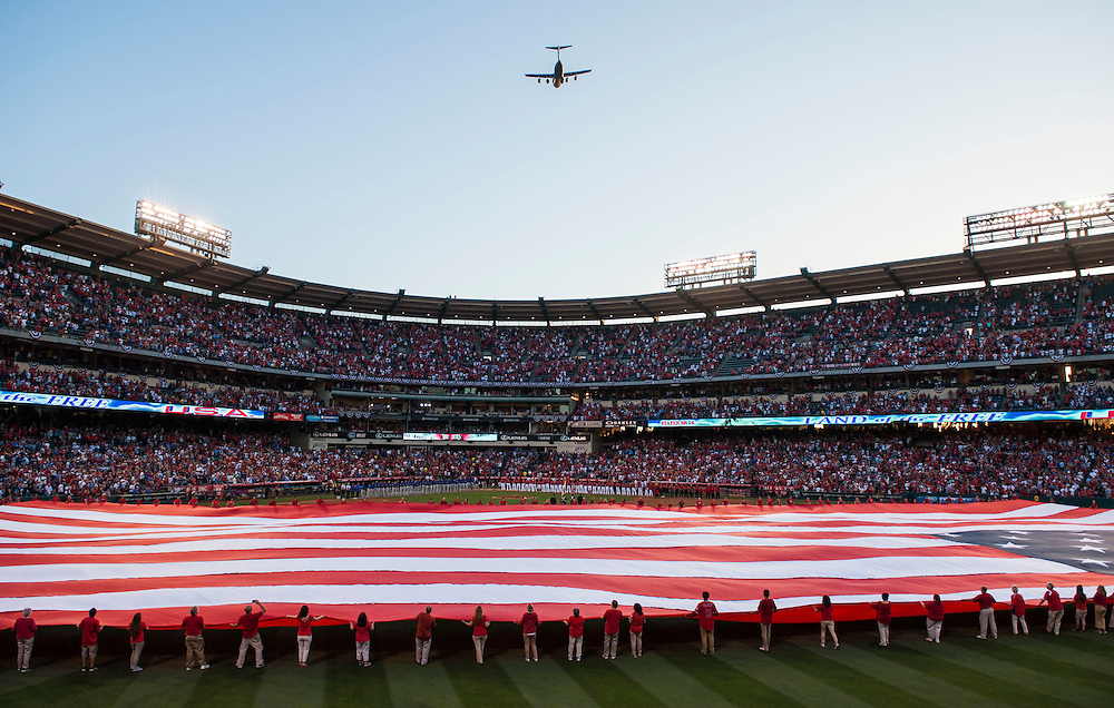 A giant American flag is unfurled in center field as a C-17 flies over Angel Stadium before the Angels' home opener Monday.<br /> <br /> ///ADDITIONAL INFO:   <br /> <br /> angels.0405.kjs  ---  Photo by KEVIN SULLIVAN / Orange County Register  --  4/4/16<br /> <br /> The Los Angeles Angels take on the Chicago Cubs during their 2016 home opener Monday at Angel Stadium.<br /> <br /> <br />  4/4/16