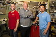 Allegro Music's repair team, from left to right, Joel Ryan, Gabe Eaton, and Cody Ng, pose for a portrait at Allegro Music in Fremont, California, on April 16, 2014. (Stan Olszewski/SOSKIphoto)