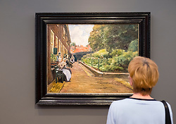 Visitor looking at painting Stevenstift in Leiden, by Max Liebermann   at new Museum Barberini in Potsdam Germany