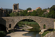 Scene in the medieval village of Lagrasse, Languedoc-Roussillon, France. It lies in the valley of the River Orbieu and is famous for it's stone bridge and The Abbey of St. Mary of Lagrasse (French: Abbaye Sainte-Marie de Lagrasse or Abbaye Sainte-Marie-d'Orbieu) a Romanesque Benedictine abbey.