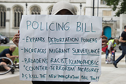 An activist holds a sign at a Kill The Bill protest in Parliament Square against the Police, Crime, Sentencing and Courts (PCSC) Bill 2021 as MPs consider amendments to the Bill in the House of Commons on 5th July 2021 in London, United Kingdom. The PCSC Bill would grant the police a range of new discretionary powers to shut down protests, including the ability to impose conditions on any protest deemed to be disruptive to the local community, wider stop and search powers and sentences of up to 10 years in prison for damaging memorials.