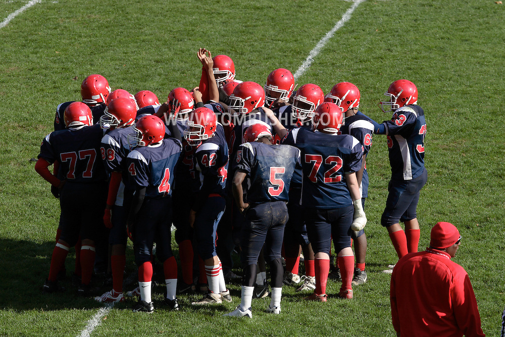 Peekskill, NY - Peekskill High School football players gather on the field before the start of the  second half of a game in Peekskill on Oct. 18, 2008.