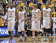 WICHITA, KS - JANUARY 05:  Players Cleanthony Early #11, Tekele Cotton #32, Ron Baker #31 and Darius Carter #12 of the Wichita State Shockers walks onto the court against the Northern Iowa Panthers during the first half on January 5, 2014 at Charles Koch Arena in Wichita, Kansas.  (Photo by Peter G. Aiken/Getty Images) *** Local Caption *** Cleanthony Early;Tekele Cotton;Ron Baker;Darius Carter