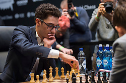 © Licensed to London News Pictures. 26/11/2018. LONDON, UK.  London, UK.  26 November 2018.  Magnus Carlsen (R) pictured) of Norway competes against Fabiano Caruana (L) of the United States in the 12th game of the World Chess Championship taking place at The College in Holborn.  The 12 game match is currently tied after 11 draws.  Photo credit: Stephen Chung/LNP