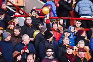 A Bradford fan holds up a pair of balloons in his team's colours before kick off during the EFL Sky Bet League 1 match between Barnsley and Bradford City at Oakwell, Barnsley, England on 12 January 2019.