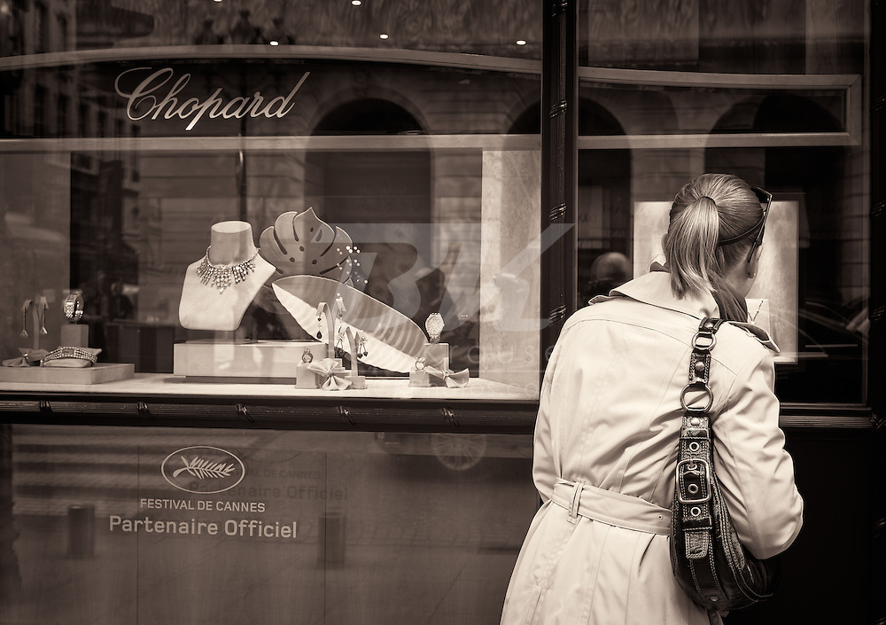 Doing a little window shopping in Paris, France on May 18, 2012.