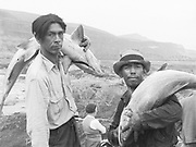 0805-M01B. Indians with fish at Celilo Falls. 1936