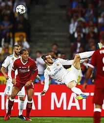 (L-R) Karim Benzema of Real Madrid CF, Virgil van Dijk of Liverpool FC, Gareth Bale of Real Madrid CF scoring 2-1 during the UEFA Champions League final between Real Madrid and Liverpool on May 26, 2018 at NSC Olimpiyskiy Stadium in Kyiv, Ukraine