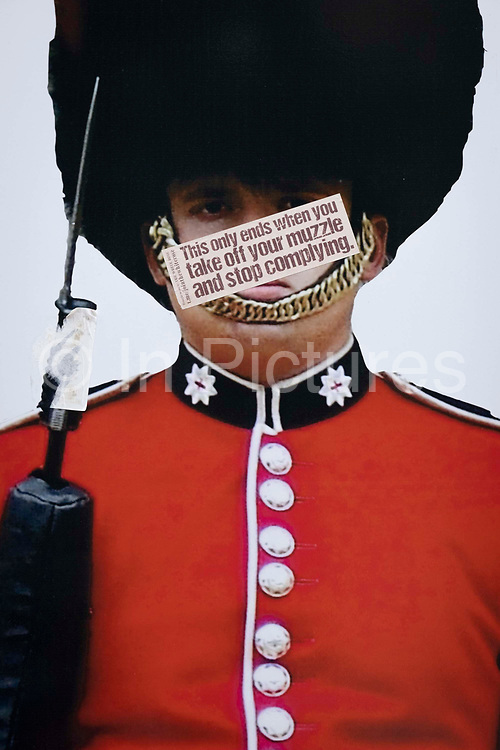 The image of a guardsmans face has been obscured by an anti-vaxx message mocking pandemic face coverings, on Covid Freedom Day. This date is what Prime Minister Boris Johnsons UK government has set as the end of strict Covid pandemic social distancing conditions with the end of mandatory face coverings in shops and public transport, on 19th July 2021, in London, England.