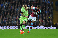 Aleksandar Kolarov of Manchester city holds off Leandro Bacuna of Aston Villa. Barclays Premier league match, Aston Villa v Manchester city at Villa Park in Birmingham, Midlands  on Sunday 8th November 2015.<br /> pic by  Andrew Orchard, Andrew Orchard sports photography.