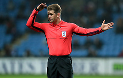 Referee Anthony Backhouse during the match between Coventry City and Peterborough United at the Ricoh Arena