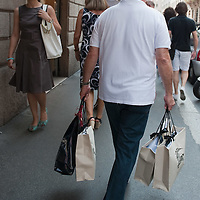 MILAN, ITALY - JULY 03:  A man with several carrier bags walks  in the fashion district of Milan on the first day of the Summer Sales on July 3, 2010 in Milan, Italy. Milan's summer sales start today. .***Agreed Fee's Apply To All Image Use***.Marco Secchi /Xianpix. tel +44 (0) 207 1939846. e-mail ms@msecchi.com .www.marcosecchi.com