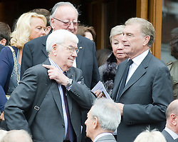 © licensed to London News Pictures. 18/05/2011. Tonbridge, UK. Frank Carson (left) and Sir Trevor Brooking (right) at the funeral of heavyweight boxing legend Sir Henry Cooper at Corpus Christi Church in Lyons Crescent, Tonbridge, Kent today (18/05/2011).  Please see special instructions for usage rates. Photo credit should read Ben Cawthra/LNP