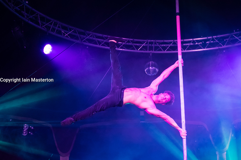 Edinburgh, Scotland, United Kingdom. 21November, 2017. Cabaret group Le Clique present their Christmas show Le Clique Noel at the Spiegeltent in Edinburgh as part of the city's annual Christmas festivities. Johnny Reah performs his on the pole.