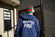 Jason Nakagami, a paramedic with the City of Milpitas, walks into the Genesis United Methodist Church wearing an elf hat and ears during a Milpitas Fire Department toy drive at Genesis United Methodist Church in Milpitas, California, on December 21, 2013. (Stan Olszewski/SOSKIphoto)