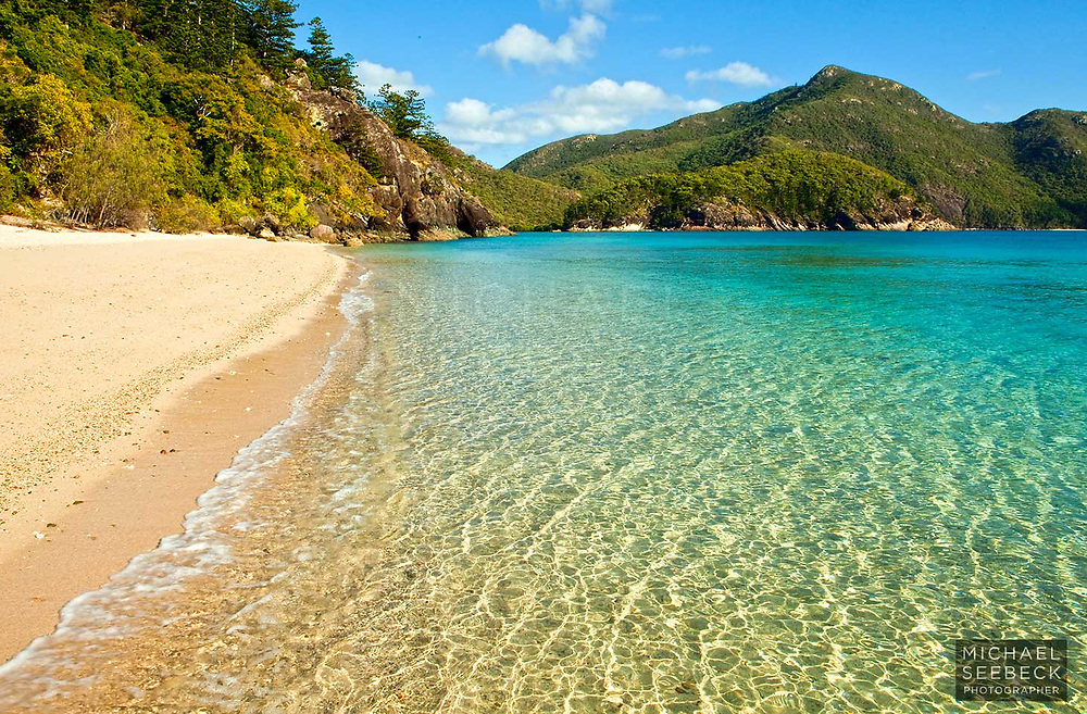 A beautiful small beach on Whitsunday Island.<br /> <br /> Code: LAQW0003<br /> <br /> Open Edition Print / Stock Image