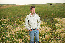 "The Nature Conservancy's Brian Martin poses in Eastern Montana  at the Matador ranch ""grass bank"". The ""grass bank"" is an innovative way to leverage conservation gains, in which ranchers can graze their cattle at discounted rates on Conservancy land in exchange for improving conservation practices on their own ""home"" ranches. In 2002, the <br /> Conservancy began leasing parts of the ranch to neighboring ranchers who were suffering from  severe drought, offering the Matador's grass to neighboring ranches in exchange for their  participation in conservation efforts. The grassbank has helped keep ranchers from plowing up native grassland to farm it; helped remove obstacles to pronghorn antelope migration; improved habitat for the Greater Sage-Grouse and reduced the risk of Sage-Grouse colliding with fences; preserved prairie dog towns and prevented the spread of noxious weeds. (Photo By Ami Vitale) his wife Jolynn plays with her daughters Janae and Layla in Eastern Montana  at the Matador ranch ""grass bank"". The ""grass bank"" is an innovative way to leverage conservation gains, in which ranchers can graze their cattle at discounted rates on Conservancy land in exchange for improving conservation practices on their own ""home"" ranches. In 2002, the <br /> Conservancy began leasing parts of the ranch to neighboring ranchers who were suffering from  severe drought, offering the Matador's grass to neighboring ranches in exchange for their  participation in conservation efforts. The grassbank has helped keep ranchers from plowing up native grassland to farm it; helped remove obstacles to pronghorn antelope migration; improved habitat for the Greater Sage-Grouse and reduced the risk of Sage-Grouse colliding with fences; preserved prairie dog towns and prevented the spread of noxious weeds. (Photo By Ami Vitale) looks at birds with his daughter Layla, 5,   in Eastern Montana  at the Matador ranch ""grass bank"". The ""grass bank"" is an innovative way to leverage conservatio"