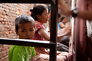 Maya  Carpet Factory does not employ children and is a licensee of the GoodWeave Foundation and their carpets carry the GWF label. It is a category C however and GWF inspectors come by regularly to check for child workers. Dilak is 6 years old. His mother says he is only just stating to be able to speak properly so she has not not wanted him to start school yet. The Good Weave Foundation is a charity set up in partnership with the Nepalese carpet industry. The aim is to eliminate child labor in all carpet factories in Nepal. Factories which do not employ children can sign up with the charity and become a licensee to the GWF brand and label their carpets with the GWF label which promises any buyers abroad that no children were involved in making the carpets.
