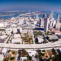 Aerial view east to Biscayne Bay and Miami Beach with Miami skyline and I-95.