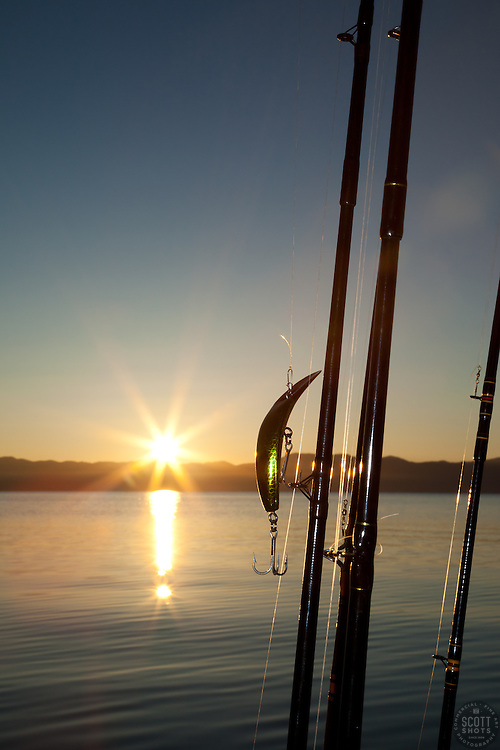 """""""Fishing Lure at Sunrise"""" - This fishing lure and rods were photographed at sunrise on Lake Tahoe."""