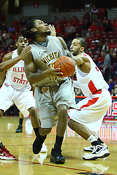 22 February 2012:  Carl Hall works his way around Jackie Carmichael during an NCAA Missouri Valley Conference mens basketball game between the Wichita State Shockers and the Illinois State Redbirds in Redbird Arena, Normal IL