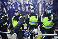 © Licensed to London News Pictures. 26/06/2021. London, UK. Police reinforce lines as Anti-vaccination and anti-lockdown demonstrators converge on Downing Street after a day of protest in Central London.  Photo credit: Guilhem Baker/LNP