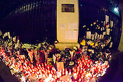 Spain reacts in solidarity with Paris After 23th November attacks with a  Candlelight Vigil at the entrance of the French Embassy