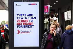 © Licensed to London News Pictures. 10/10/2019. London, UK. Members of public walk past a digital billboard featuring the UK government's latest 'Get Ready for Brexit' advertising campaign in Wood Green Shopping Mall, north London, with twenty one days to Brexit day. The 'Get Ready for Brexit' campaign is costing the UK government £100m. Photo credit: Dinendra Haria/LNP