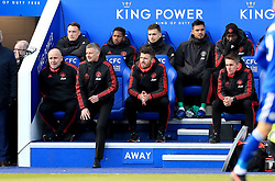 Manchester United caretaker manager Ole Gunnar Solskjaer (second left) watches the action from the bench during the Premier League match at the King Power Stadium, Leicester.