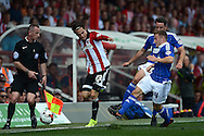 Ryan Fraser of Ipswich Town (r) tackles Jota of Brentford. Skybet football league Championship match, Brentford v Ipswich Town at Griffin Park in London on Saturday 8th August 2015.<br /> pic by John Patrick Fletcher, Andrew Orchard sports photography.