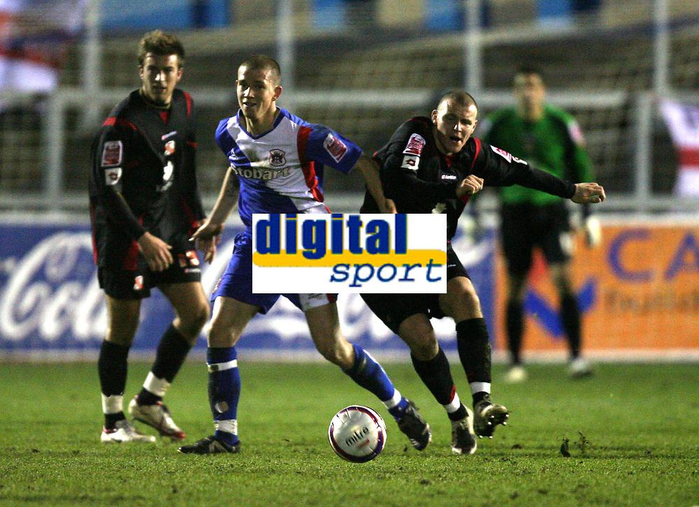 Photo: Paul Greenwood/Sportsbeat Images.<br />Carlisle United v Swindon Town. Coca Cola League 1. 04/12/2007<br />Swindon's Jon Paul McGovern (R) looses the ball to the challenge of Joe Garner