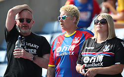Crystal Palace fans in the stands during a pre season friendly match at The Kassam Stadium, Oxford.