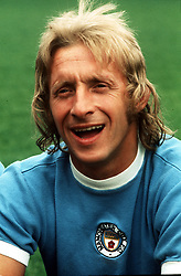Footballer Denis Law, pictured in his Manchester City shirt, 1974.