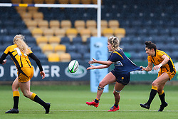 Alex Callender of Worcester Warriors Women is tugged back  as she passes - Mandatory by-line: Nick Browning/JMP - 24/10/2020 - RUGBY - Sixways Stadium - Worcester, England - Worcester Warriors Women v Wasps FC Ladies - Allianz Premier 15s