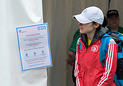 © Licensed to London News Pictures; 15/03/2020; Bath, UK. A coronavirus notice at the medical tent at the Bath Half Marathon during the coronavirus crisis. There have been calls to cancel or postpone the event after many other sporting and other events have been cancelled or postponed as cases of infection and deaths due to the virus increase across the UK, and the Government plans to bring in legislation to ban all large public gatherings perhaps as early as next weekend. Organisers of the half marathon say they have taken advice that the risk is low and say that it is too late to cancel the event. Photo credit: Simon Chapman/LNP.