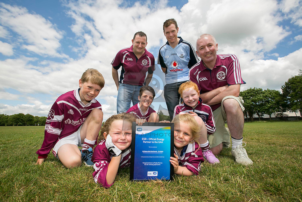 Repro Free: Dublin July 2015: ESB, Official Energy Partner to the GAA, presents St Finians GAA Club in Swords with a cheque for €1,500. The prize is part of ESB's GAA Fund whereby ESB staff members nominated a local GAA club that is making a difference in the community. Over the coming weeks, a grand total of €30,000 will be awarded to twenty GAA clubs across the country. <br /> <br /> St Finians GAA Club was nominated for the award by ESB staff member Paddy Mulvey.<br /> <br /> Pictured at the presentation in the club is Barry Shelly, Chairman, St Finians GAA Club, Paddy Mulvey from ESB and Pat Farrell, Club Tresurer with junior club members John Sylvester (10), Lauren Derver (6), James Donnelly (11), Lily Sylvester (5) and Yvie Derver (8). Picture Andres Poveda<br /> <br /> <br /> ENDS<br /> <br /> For further information, please contact:<br /> Wilson Hartnell<br /> Rachel Solon / Sarah Gallagher<br /> rachel.solon@ogilvy.com / sarah.gallagher@ogilvy.com    <br /> 01 6690030 / 087 6245326 / 086 3517969