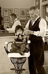 20 March 2016. New Orleans, Louisiana. <br /> New Orleans' bespoke gentlemen's barber  Aidan Gill gives Jac Mendoza a haircut.<br /> Photo; Charlie Varley/varleypix.com