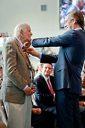 06 June 2014. The National WWII Museum, New Orleans, Lousiana. <br /> WWII veteran T5 Eugene Lussan, 473rd Infantry is honored with the French Legion of Honor medal by French Consul General, Claude Brunet..<br /> Photo; Charlie Varley/varleypix.com