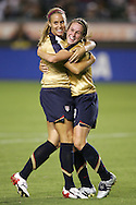25 August 2007: US midfielder Leslie Osborne (left) congratulates teammate Heather O'Reilly (right) on her second half goal. The United States Women's National Team defeated the Women's National Team of Finland 4-0 at the Home Depot Center in Carson, California in an International Friendly soccer match.