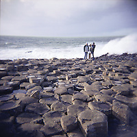 Looking out to sea at The Giants Causeway geological phenomenon with hexagonal columns formed by lava cooling during Tertiary period in Antrim Northern Ireland