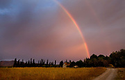 Rainbow over field in countryside, Lagrasse, France