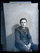 deteriorating vintage portrait of an young adult man in suit France, circa 1930s