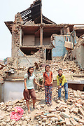 Siblings Saraswati (11) and twins Yamuna and Jamuna (8) stand on the rubble outside the remains of their family home. The children were outside their home in Bhaktapur when the earthquake struck on 29th April, 2015. Whilst they all survived, their family home was destroyed, leaving them to take shelter beneath tarpaulins erected outside.