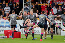 Hull KR players warm up with Offload state of mind tshirts during the Betfred Super League match at the Mend-A-Hose Jungle, Casteford.