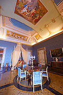 """""""The Bedroom of Francis II"""". The room furnished with a four poster bed, chest of drawers and table in the Empire Style in mahogany & gilt. The vaulted ceiling is freaked with an allegory of the victory of Napoleon over the Bourbons: the Glory of Thesus slaying the Minataur, by Giuseppe Cammarano  .  The Bourbon Kings of Naples Royal Palace of Caserta, Italy. .<br /> <br /> Visit our ITALY HISTORIC PLACES PHOTO COLLECTION for more   photos of Italy to download or buy as prints https://funkystock.photoshelter.com/gallery-collection/2b-Pictures-Images-of-Italy-Photos-of-Italian-Historic-Landmark-Sites/C0000qxA2zGFjd_k<br /> <br /> <br /> Visit our EARLY MODERN ERA HISTORICAL PLACES PHOTO COLLECTIONS for more photos to buy as wall art prints https://funkystock.photoshelter.com/gallery-collection/Modern-Era-Historic-Places-Art-Artefact-Antiquities-Picture-Images-of/C00002pOjgcLacqI"""